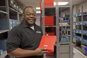 Employee Showing Media Storage Supplies