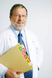 Senior doctor with medical files