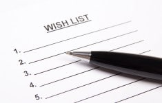 close up of blank wish list and metal pen