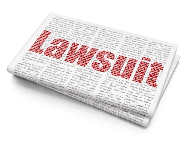 red text Lawsuit on Newspaper