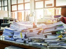 Close up of business documents stack on desk report papers stack