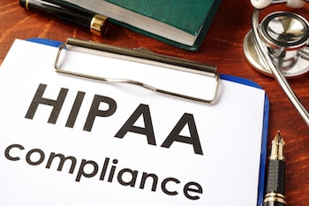 HIPAA compliance form on a clipboard. Medical privacy concept.