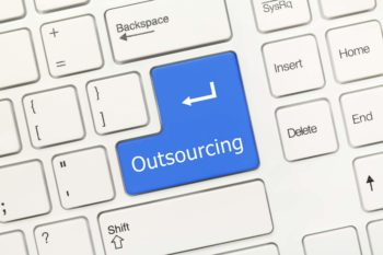 Close-up view on white conceptual keyboard - Outsourcing (blue key)