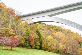 detail of Double Arch Bridge at Natchez Trace Parkway near Franklin, TN with a forest in fall colors