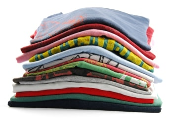 pile of colorful t-shirts isolated on white background